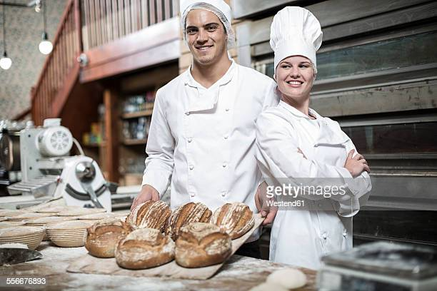 Two bakers and their fresh bread