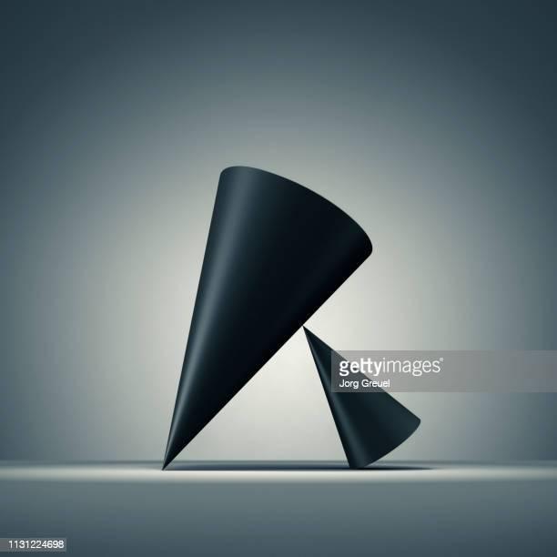 Two balancing cones