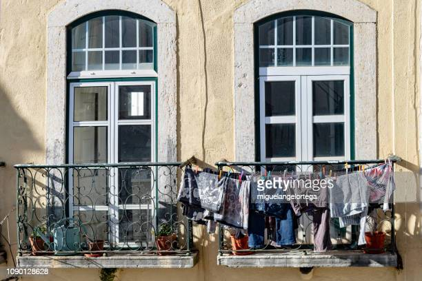 Two balconies with hanging clothes