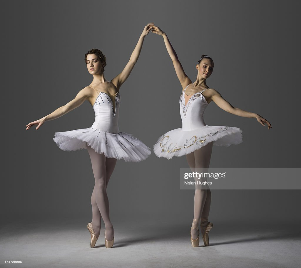 Two ballerinas performing Relevé on Pointe 5th : Stock Photo