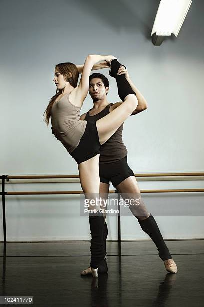 Two ballet dancers in rehearsal at dance studio.
