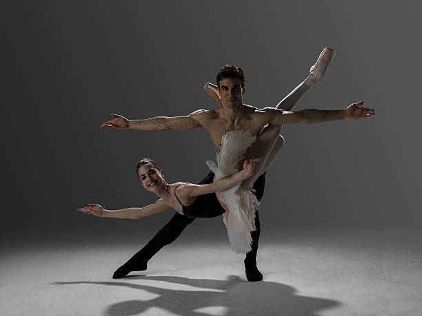 two ballet dancers performing Pas de Deux fish