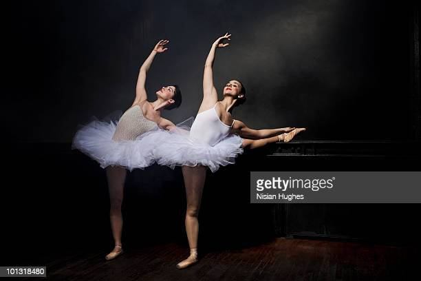 Two ballet dancers stretching