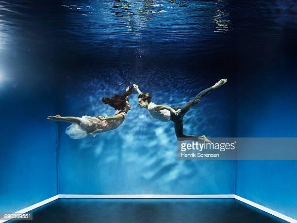 Two ballet dancers underwater
