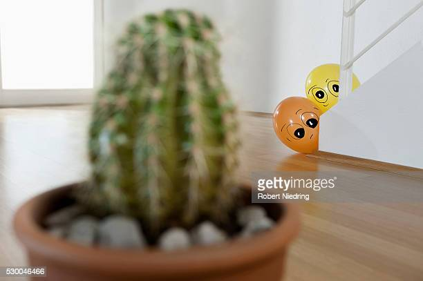 Two balloons peeking cactus, Bavaria, Germany