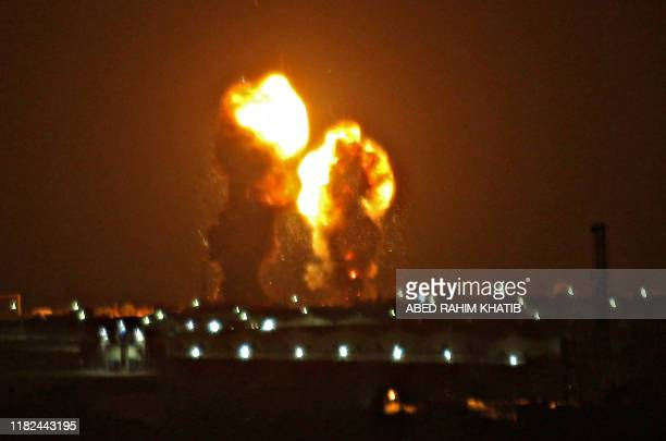 Two balls of fire are seen following an Israel airstrike in Khan Yunis in the southern Gaza Strip early on November 15, 2019. - An Israel launched...