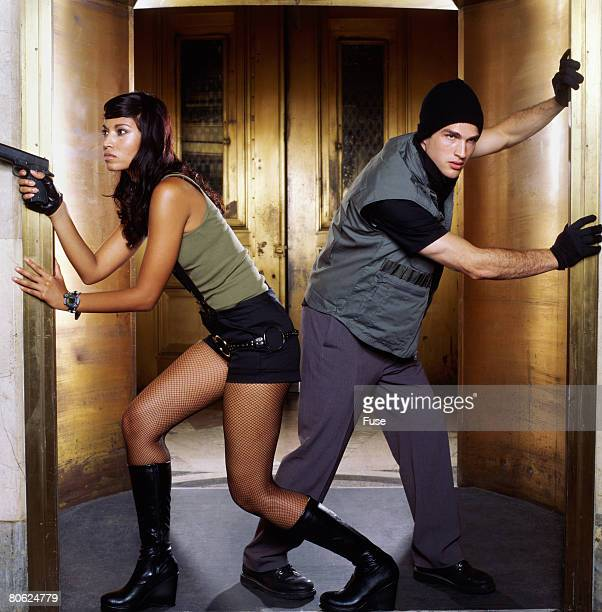 Two Bank Robbers Running Through Doorway