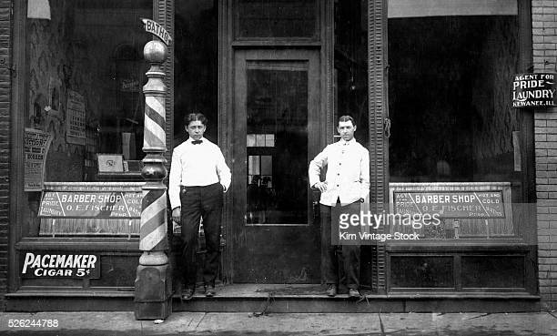 Two barbers await some customers ca 1905