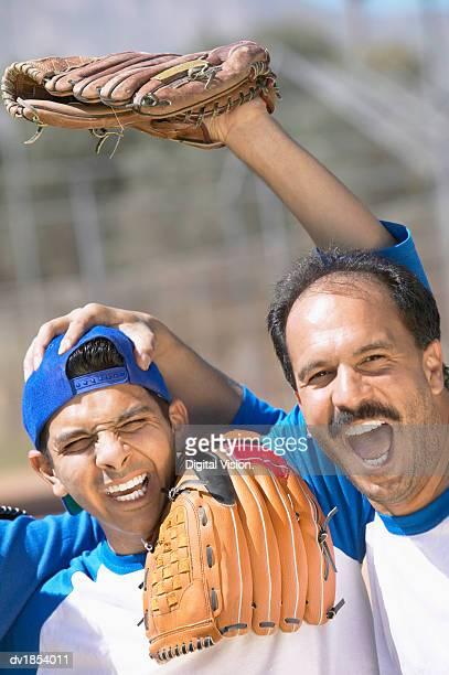 Two Baseball Players Celebrating Together