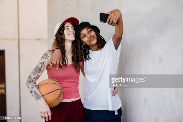 two basketball girlfriends taking a selfie - youth culture stock pictures, royalty-free photos & images