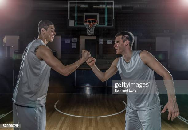 Two Basketball Player fist bump each other