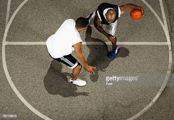 Two Basketball Players Competing
