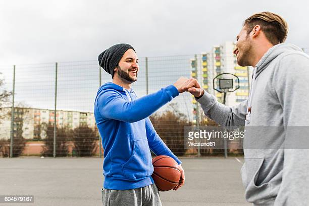 Two basketball players greeting