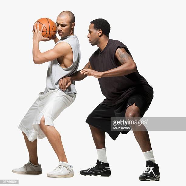 two basketball players - ドリブル ストックフォトと画像
