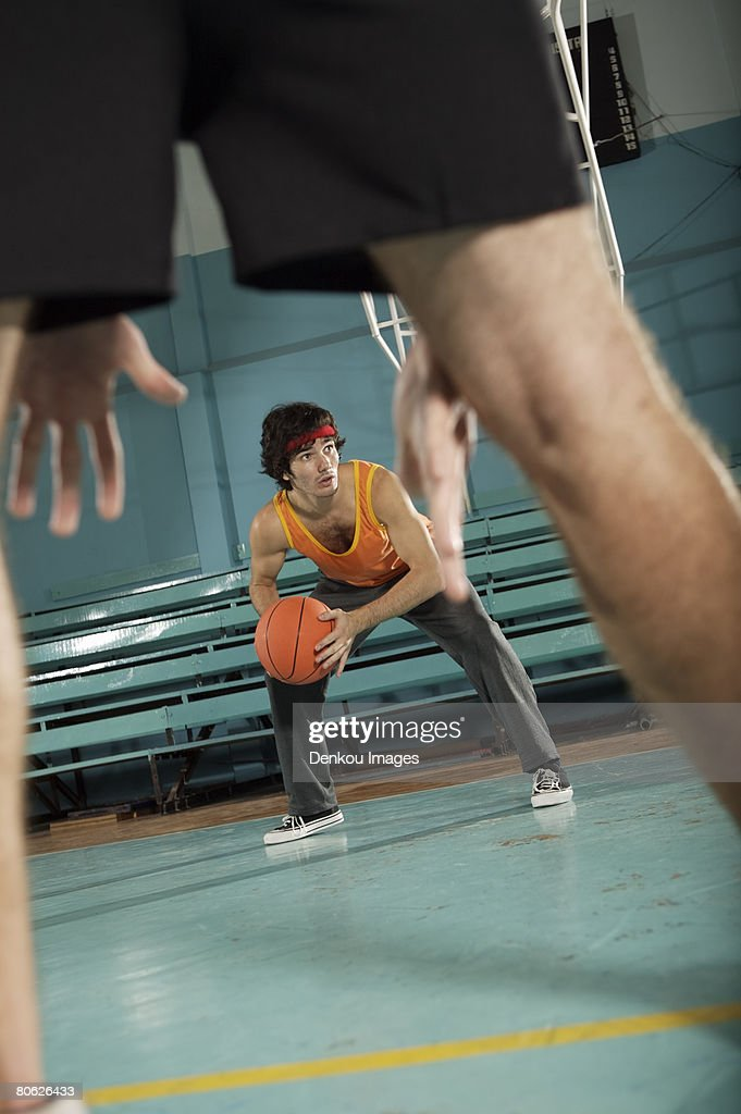 Two basketball players playing basketball : Bildbanksbilder