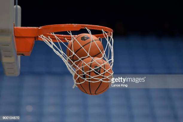 Two basketballs fall through a net prior to the game between the Wake Forest Demon Deacons and the North Carolina Tar Heels at Dean Smith Center on...