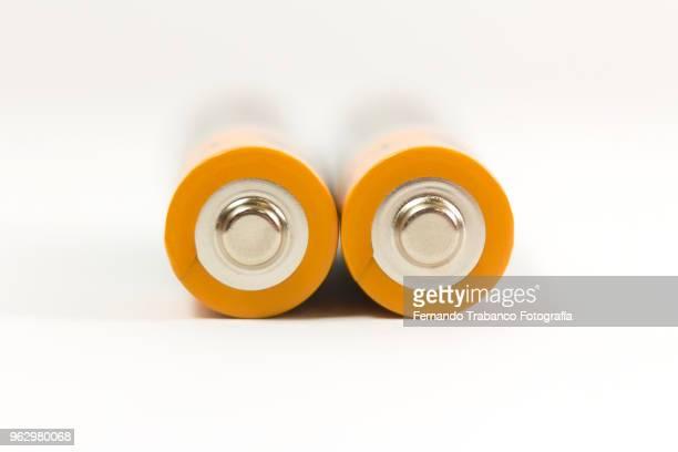 two batteries - due oggetti foto e immagini stock
