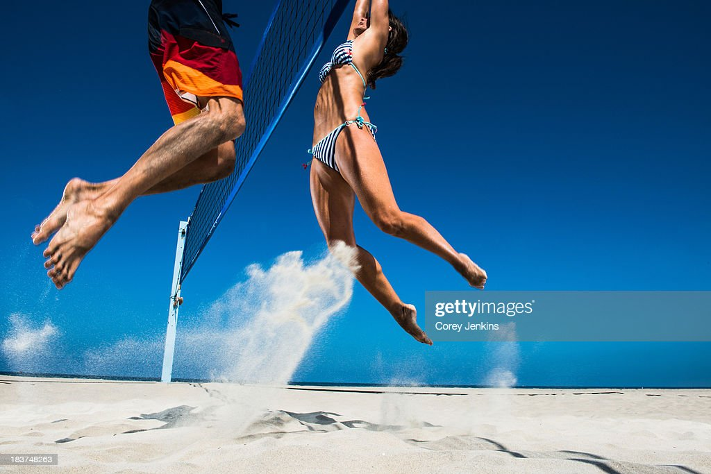Two beach volleyball players blocking at net : Stock Photo