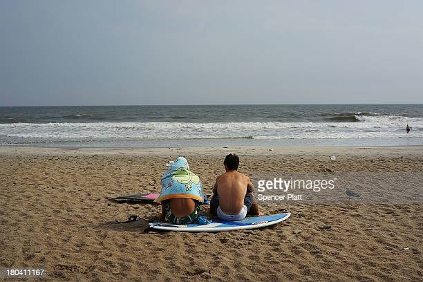 Two beach-goers relax in the late afternoon at Rockaway Beach on September 12, 2013 in the Queens borough of New York City. Despite the sustained...