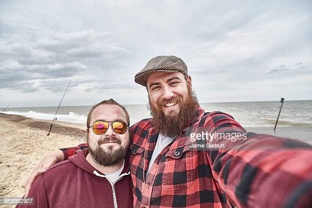 Two Bearded males taking a selfie whilst fishing