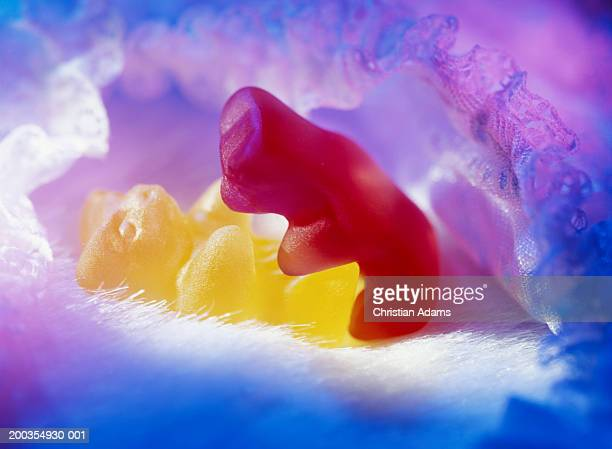 two bear-shaped sweets 'embracing', close-up - gummi bears stock photos and pictures