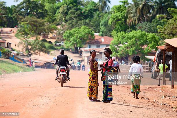 two beautiful african women on the street - monrovia liberia stock photos and pictures
