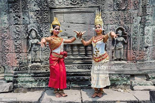 two beautiful apsara dancers, angkor, cambodia - cambodian culture stock photos and pictures
