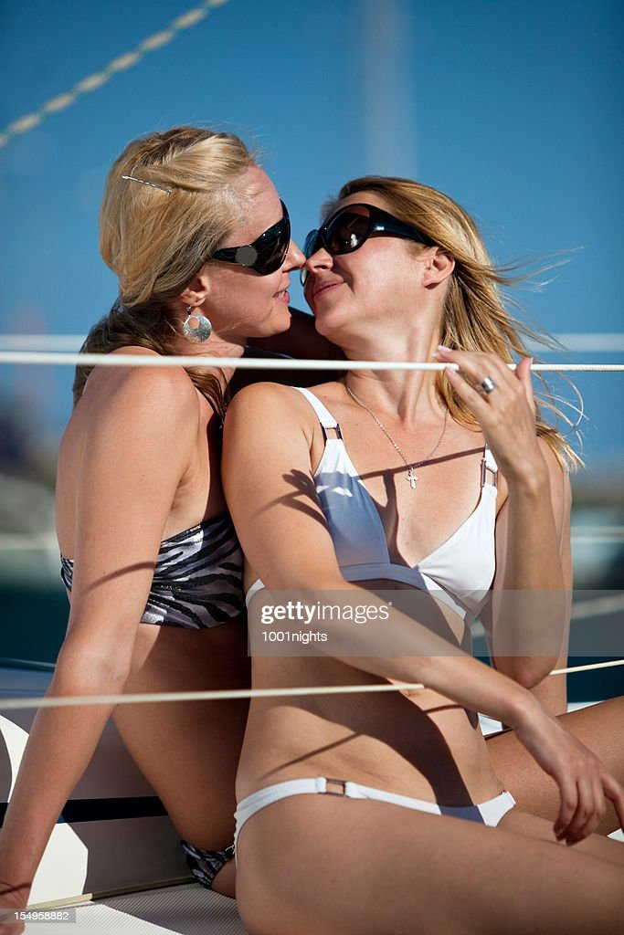 Two beautiful blonde women : Stock Photo