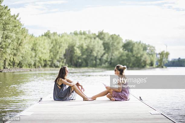 Two beautiful girl on a pier