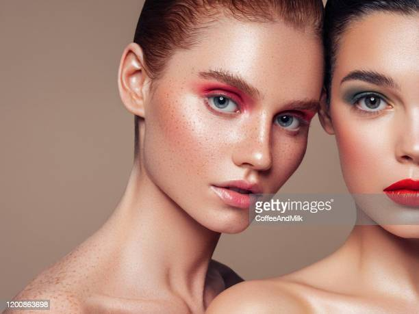 two beautiful girls with make-up - fashion model stock pictures, royalty-free photos & images