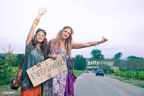Two beautiful Hippie teenager Hitchhiking on roadside