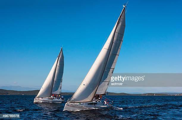 Two Beautiful Sailboats Racing  at Regatta