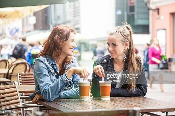 Two beautiful teenagers take a break