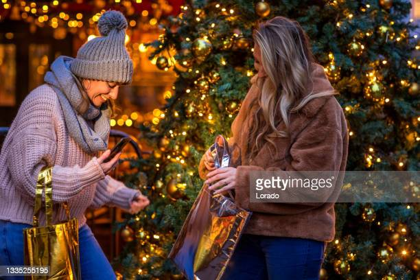 two beautiful women at winter shopping - north holland stock pictures, royalty-free photos & images