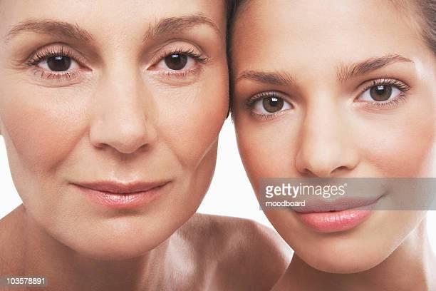 two beautiful women, different ages - zij aan zij stockfoto's en -beelden
