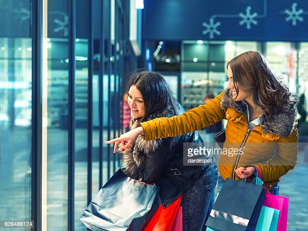 Two beautiful women in shopping