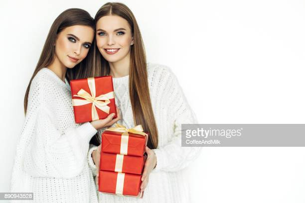 two beautiful women - christmas gifts stock photos and pictures