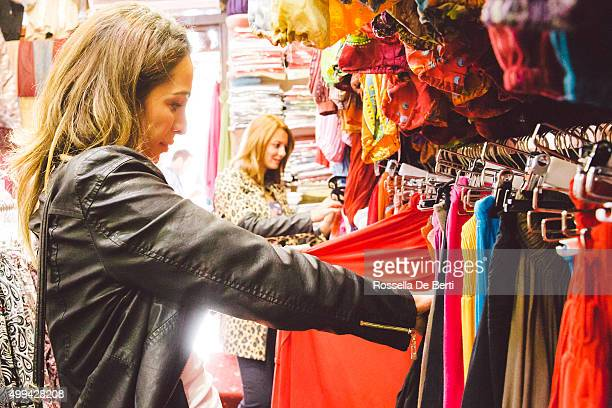 Two Beautiful Women Shopping Traditional Clothes