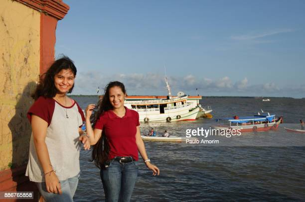 Two beautiful young girls enjoying at the Amazon in Brazil