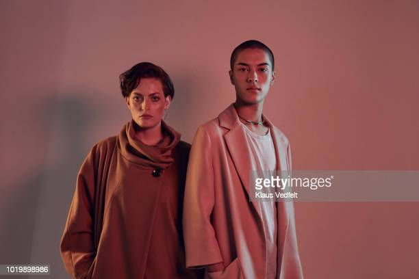 two beautiful young people looking in camera - fashion photos et images de collection