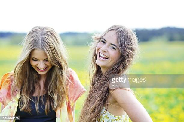 Two beautiful young woman laughing
