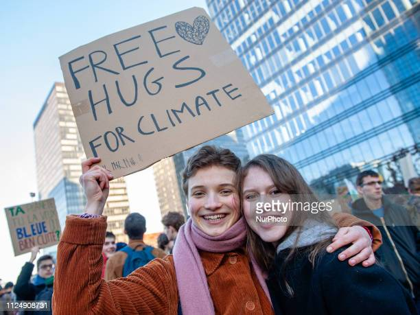Two Belgian students are holding a placard over her heads during the demonstration for better climate policy began in Brussels on February 14th 2019
