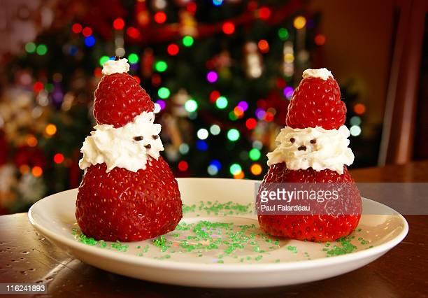 two berries in shape of santa claus - sapin de noel humour photos et images de collection