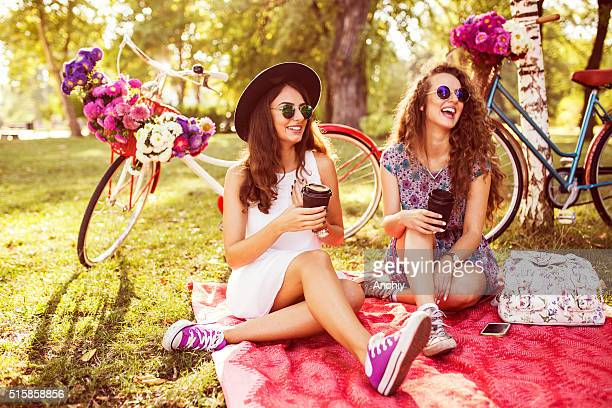 two best friends drinking coffee to go in nature - a fall from grace stock pictures, royalty-free photos & images