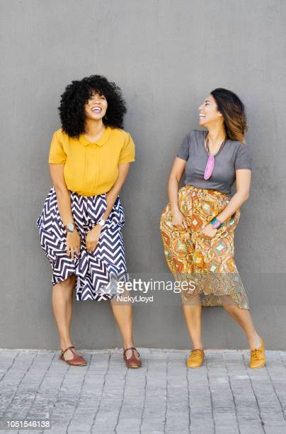 two best friends having fun and laughing together - black skirt stock pictures, royalty-free photos & images