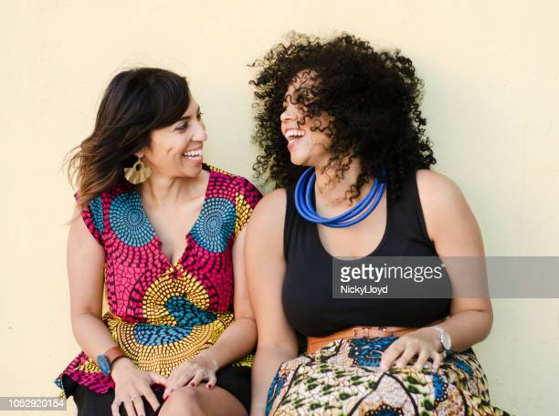 two best friends laughing and having fun together - curvy women stock pictures, royalty-free photos & images