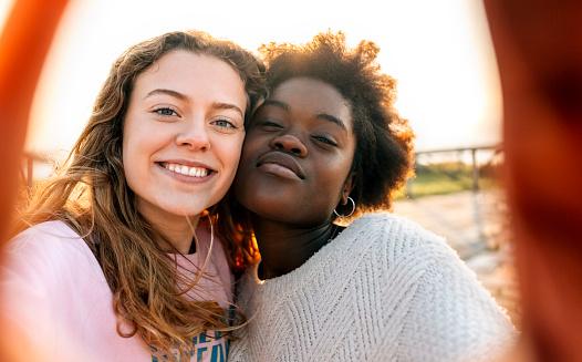 Two best friends making a selfie outdoors - gettyimageskorea