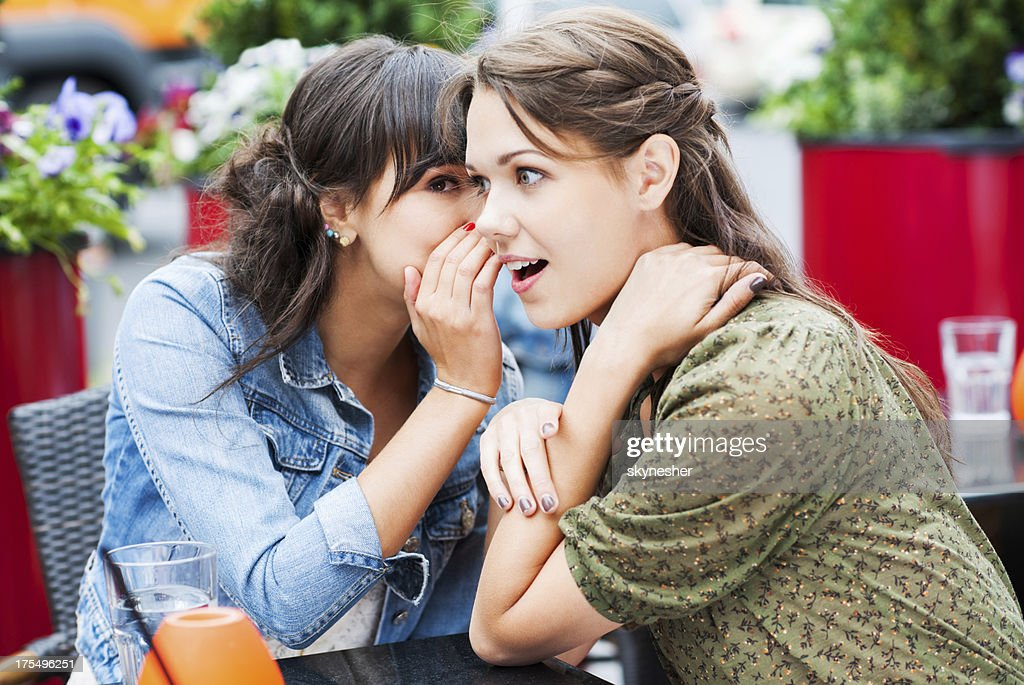 Two best friends sitting in a cafe and gossiping, : Stock Photo