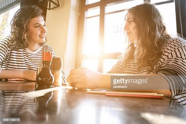 two best friends talking - chubby teen stock photos and pictures