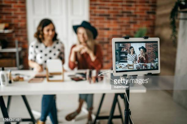 two best friends vlogging about make up - live streaming stock pictures, royalty-free photos & images